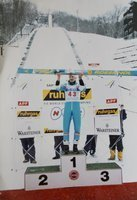 Photo of Adam Malysz on the FIS World Cup Ski Jumping podium